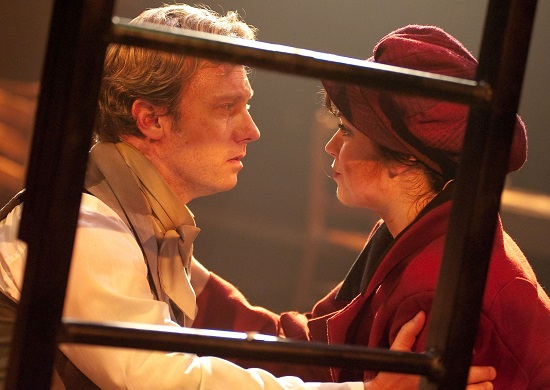 Marius (played by Jeffrey S. Shankle) pleads with Eponine (played by MaryKate Brouillet) to leave the barricade for safety and deliver a letter to Cosette.  Photo by Kirstine Christainsen.