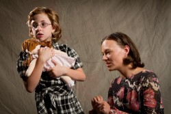 Gloria (Isabelle Herlinger, with doll) and Susy (April Rejman). Photo courtesy of The Vagabond Players.