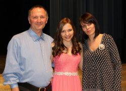 Agne Giedraityte at the concert, surrounded by her proud parents.