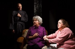"""Rose (Joan Crooks) exclaims, """"He's here!"""" as Arlene (Brenda R. Crooks) tries to help Rose concentrate on the living.Photo by Ken Stanek - Ken Stanek Photograph."""