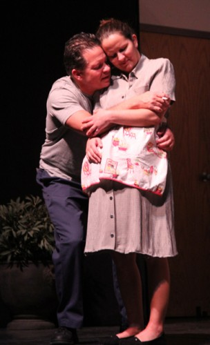 Stanley (Doug Graupman) reassures his wife (Joanna Kenlon) that everything will go back to normal after her sister leaves. Photo by Larry Carbaugh.
