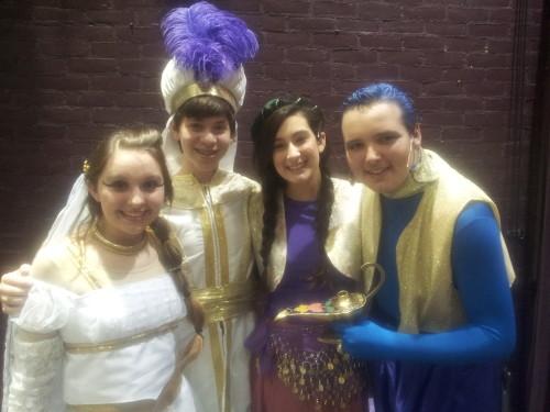 "Sheridan Merrick (Princess Jasmine), Gino Cardoni (Aladdin), Zoe Feldman (Narrator ""Heather""), and Zach Miller (Genie).  Photo by Mark Beachy."