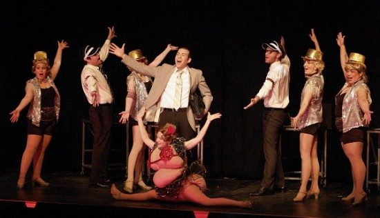 Leo (Brian Sackett) and the Chorus Girls of 'The Producers.' Photo by Steve Tyler.