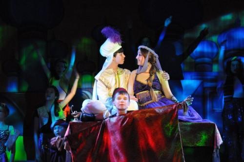 Wesley Brown (Magic Carpet), Gino Cardoni (Aladdin), and Sheridan Merrick (Princess Jasmine).  Photo by Karis Haslam.
