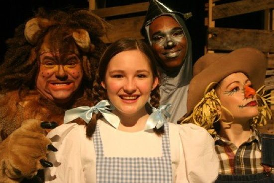 Dorothy (Clare Peyton) surrounded by Lion (B Thomas Rinaldi), TInman (Derek Cooper) and Scarecrow (Kelsey Painter). Photo courtesy of Pumpkin Theatre.