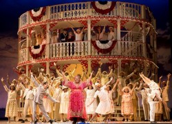 Angela Renée Simpson as Queenie (center, in pink dress) and the company of Show Boat. Photo by Scott Suchman.