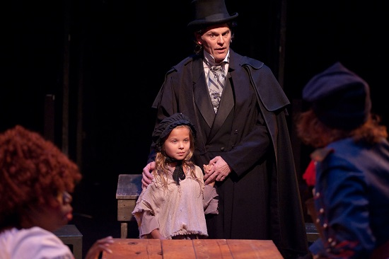 Jean Valjean (played by Daniel Felton) pays the Thenardiers to take young Cosette (played by Ella Boodin) to raise her in a warm and loving home.  Photo by Kirstine Christainsen.