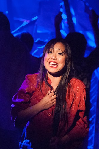 Diana Huey plays the Vietnamese bargirl Kim. Photo by Christopher Mueller.