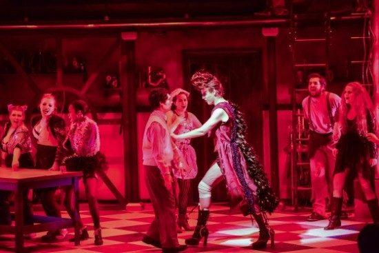 Jesse D. Saywell as Brad, Matthew Rubbelke as Frank -N- Furter, and the cast.  Photo credit to American University.