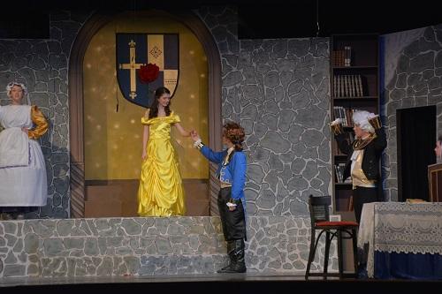 Mrs. Potts (Logan White), Belle (Emily Flack), Beast (David Jarzen), Lumiere (William Havranek), and Cogsworth (Claire Havranek).  Photo by ACCT.