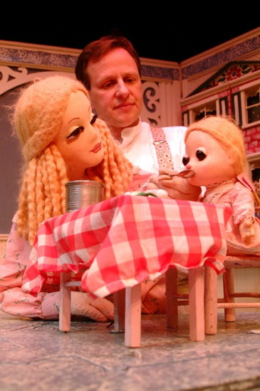 Puppeteer Christopher Hudert helps the governess feed her doll Lucinda. Photo by Christopher Piper.