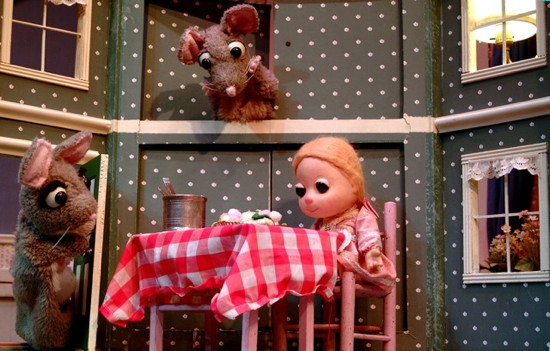 Two bad mice wait for Lucinda to leave the dollhouse so they can misbehave. Photo by Christopher Piper.
