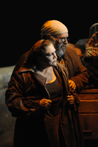 Kathleen Turner as Mother Courage and Jack Willis as the Cook. Photo by Stan Barouh.