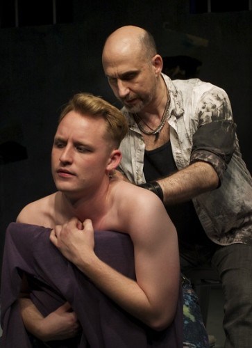 "Tanner Medding as Canvas (L.) gets ""inked"" by Steve Satta as Artist. Photo by Daniel Ettinger."