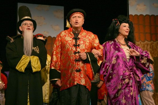 """From left, Eileen Kent as """"Inspector Chu,"""" Colin Davies as """"Emperor"""" and Teri Allred as """"Empress."""" Photo by J. Andrew Simmons."""
