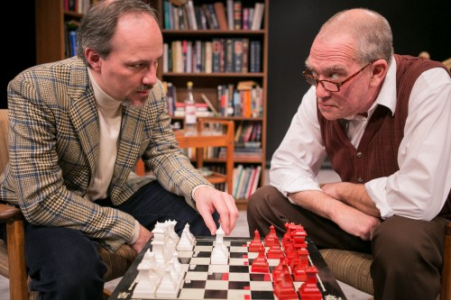 """Steven Carpenter (Mark) and Conrad Feininger (Sebastian) face off over a chess set in the Washington Stage Guild's production of """"In Praise of Love."""""""