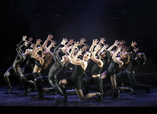 Terra C. MacLeod as Velma Kelly and the cast of Chicago the Musical. Photo by Paul Kolnik.