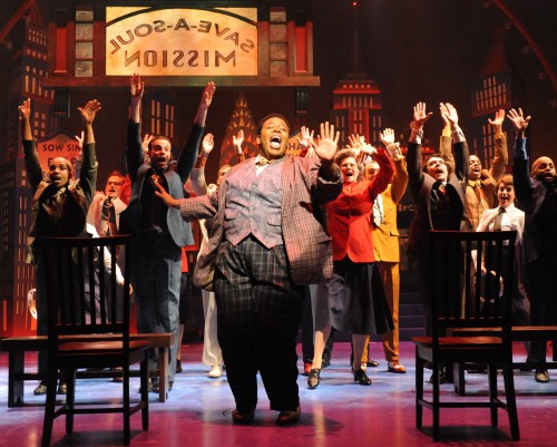 """Tobias Young as Nicely-Nicely leads Guys and Dolls company in """"Sit Down, You're Rockin' the Boat."""" Photo: Stan Barouh"""