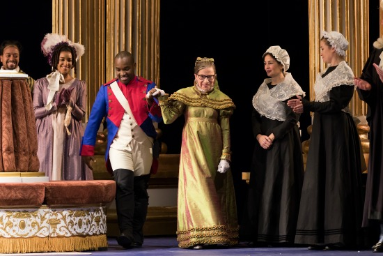 Tenor Lawrence Brownlee escorts Justice Ruth Bader Ginsburg at the curtain call of The Daughter of the Regiment – photo by Scott Suchman for WNO