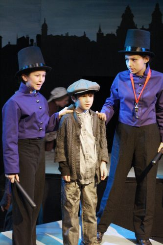 James Durham as Oliver Twist with members of the Learning Theatre Ensemble.