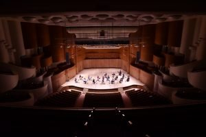 Photo of the BSO string orchestra in the emptyMeyerhoff Symphony Hall